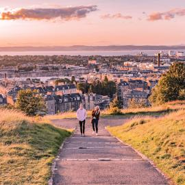 Two people walking up a hill in Edinburgh